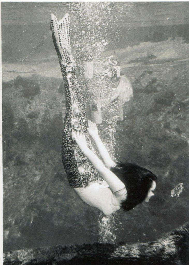 Barbara Wynn's performing as a mermaid.