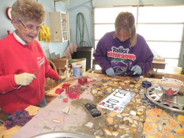Volunteers working on mosaics.